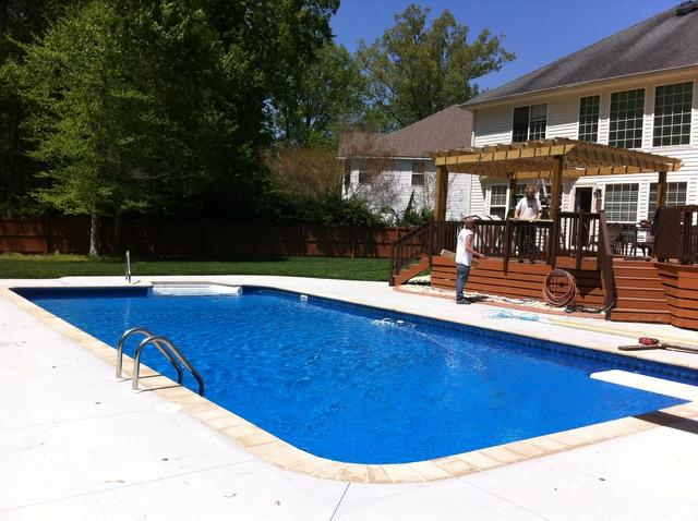Rectangle with 2' radius corners, custom coping stone