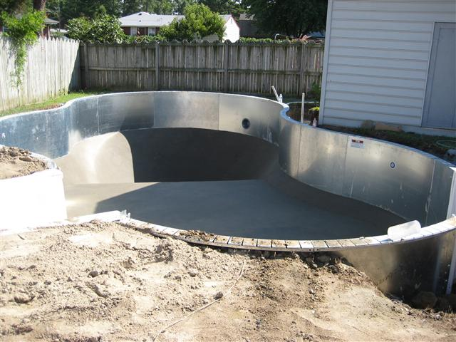 Custom Free Form inground pool...tight squeeze. Nicest people in town....Best Steaks award! Copyright Patriot Pools of Virginia LLC.